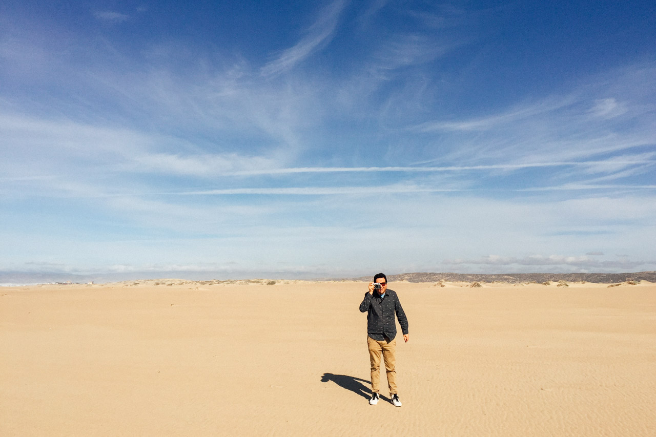 Gabe taking photos on the Guadalupe Dunes ~ Photo taken on an iPhone